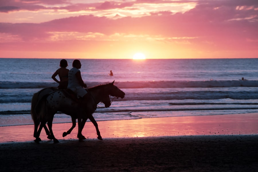 Horseback riding at sunset on the beach in Costa Rica by Tripps Plus