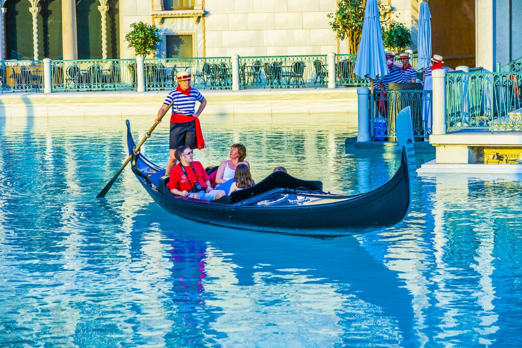 : Venice Theme Venetian with Gondola on water and Caesars Casino Hotel by Tripps Šlus Las Vegas